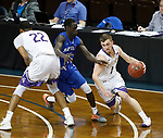 SIOUX FALLS, SD - MARCH 8:  xxxxxxxxxxxxxxxxxx #1 from the College of Idaho gets a step around xxxxxxxxx #4 from Mayville State at the 2018 NAIA DII Men's Basketball Championship at the Sanford Pentagon in Sioux Falls. (Photo by Dick Carlson/Inertia)