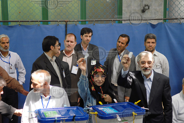 Mir-Hossein Mousavi (right), opposition candidate in the 2009 presidential election, casting his vote at Ershad mosque. He is accompanied by his wife Zahra Rahnavard, a writer, artist and political scientist.