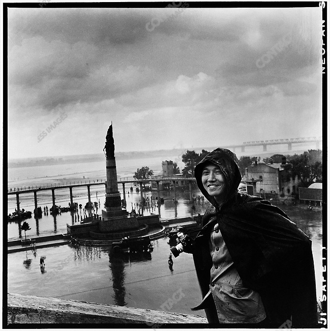 Li on the bank of the Songhua River in Harbin on the second anniversary of Mao's historic swim in the Yangtze. In the background is the Big Floods Memorial, built following the devastating floods in the summer of 1958 (photograph by Wang Zhili). 16 July 1968