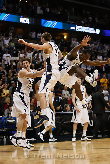 Trent Nelson  |  The Salt Lake Tribune.BYU's Jimmer Fredette, Kyle Collinsworth and Charles Abouo celebrate as BYU defeats Gonzaga in the NCAA Tournament, men's college basketball at the Pepsi Center in Denver, Colorado, Saturday, March 19, 2011, earning a trip to the Sweet 16.
