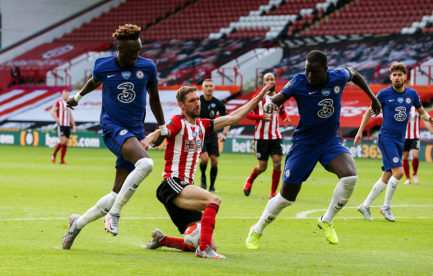 Sheffield United's Chris Basham battles with Chelsea's Tammy Abraham and Kurt Zouma<br /> <br /> Photographer Alex Dodd/CameraSport<br /> <br /> The Premier League - Sheffield United v Chelsea - Saturday 11th July 2020 - Bramall Lane - Sheffield<br /> <br /> World Copyright © 2020 CameraSport. All rights reserved. 43 Linden Ave. Countesthorpe. Leicester. England. LE8 5PG - Tel: +44 (0) 116 277 4147 - admin@camerasport.com - www.camerasport.com