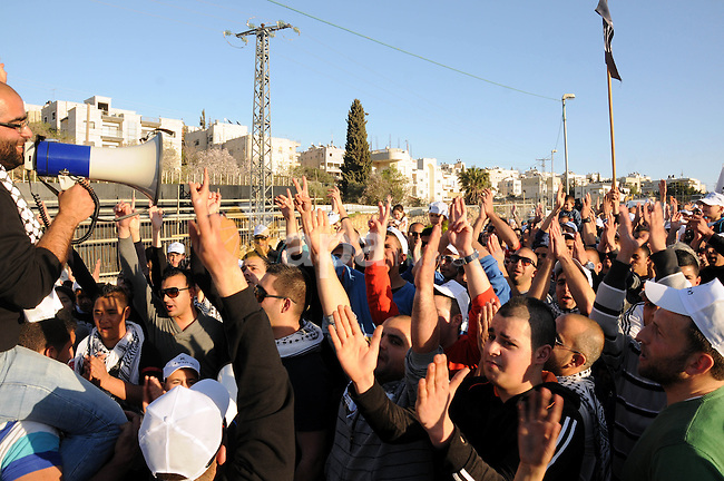 Palestinians take part in a protest against the opening project of the street number (4) in the middle of Bet Safafa neighbourhood, which is for settlement project services, in Jerusalem on February 26, 2013. Photo by Mahfouz Abu Turk
