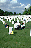 Dad age 35 and children age 3 through 9 Fort Snelling Military Cemetery on Memorial Day.  Minneapolis Minnesota USA