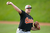 Matt Hobgood #34 of the Bluefield Orioles warms up prior to pitching against the Johnson City Cardinals at Howard Johnson Field August 1, 2009 in Johnson City, Tennessee. (Photo by Brian Westerholt / Four Seam Images)