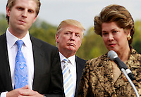 Donald trump, middle, listen intently as his son Eric Trump, left, and Patricia Kluge, right, field questions during a press conference announcing the grand opening of Trump Vineyard Estates Tuesday in Charlottesville, Va. Trump purchased the foreclosed vineyard, previously owner by Patricia Kluge, at auction earlier this year. Photo/The Daily Progress/Andrew Shurtleff