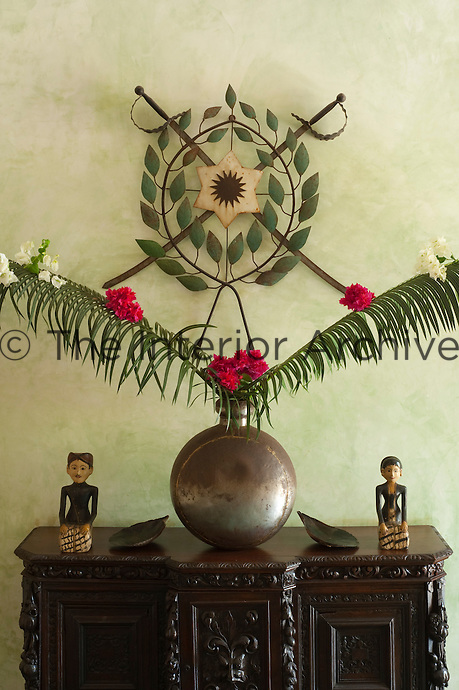Detail of an exotic flower display on a sideboard in the entrance hall