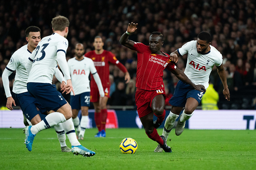 Liverpool's Sadio Mane battles for possession with Tottenham's Japhet Tanganga <br /> <br /> Photographer Stephanie Meek/CameraSport<br /> <br /> The Premier League - Tottenham Hotspur v Liverpool - Saturday 11th January 2020 - Tottenham Hotspur Stadium - London<br /> <br /> World Copyright © 2020 CameraSport. All rights reserved. 43 Linden Ave. Countesthorpe. Leicester. England. LE8 5PG - Tel: +44 (0) 116 277 4147 - admin@camerasport.com - www.camerasport.com