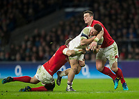 Englands' Sam Simmonds is tackled by Wales' Hadleigh Parkes<br /> <br /> Photographer Bob Bradford/CameraSport<br /> <br /> NatWest Six Nations Championship - England v Wales - Saturday 10th February 2018 - Twickenham Stadium - London<br /> <br /> World Copyright &copy; 2018 CameraSport. All rights reserved. 43 Linden Ave. Countesthorpe. Leicester. England. LE8 5PG - Tel: +44 (0) 116 277 4147 - admin@camerasport.com - www.camerasport.com