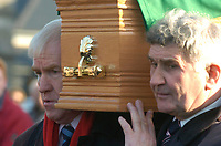 Tim Kennelly Funeral 10-12-05<br /> Jimmy Deenihan and Mick O'Dwyer carry the remains of former Kerry footballer Tim Kennelly in Listowel on Saturday.<br /> Picture by Don MacMonagle