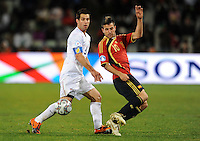 Cesc Fabregas of Spain and Carlos Bocanegra of USA. USA defeated Spain 2-0 during the semi-finals of the FIFA Confederations Cup at Free State Stadium in Manguang/Bloemfontein, South Africa on June 24, 2009..