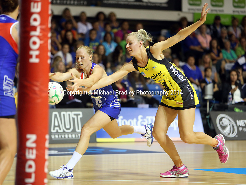 10.03.2014 Mystics laura Langman and Pulse's Katrina Grant in action during the ANZ Champs match between the Northern Mystics and Hairer Pulse played at the Trusts Arena in Auckland. ©Michael Bradley.