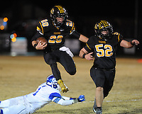 NWA Democrat-Gazette/ANDY SHUPE<br /> Blake Faulk (20) of Prairie Grove hurdles Eric Briggs of Star City as Dakota Hutchison (52) blocks Friday, Nov. 27, 2015, during the first half of play at Tiger Stadium in Prairie Grove. Visit nwadg.com/photos to see more photographs from the game.