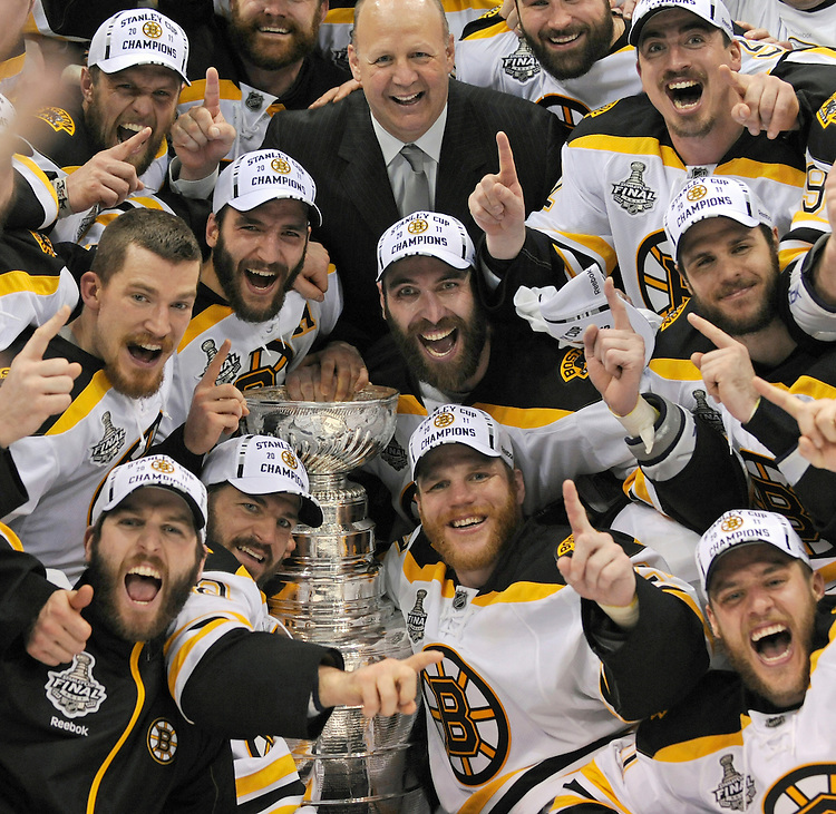 Members of the Boston Bruins celebrate their Stanley Cup victory over the Vancouver Canucks in Vancouver, BC, on Wednesday, June 15, 2011.