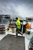 CANADA, Vancouver, British Columbia, Deck Hand Peter Chaucer stacks Spotted Prawns pots on the boat Organic Ocean