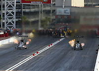 Apr 10, 2015; Las Vegas, NV, USA; NHRA top fuel driver Shawn Langdon (right) races alongside Dave Connolly during qualifying for the Summitracing.com Nationals at The Strip at Las Vegas Motor Speedway. Mandatory Credit: Mark J. Rebilas-
