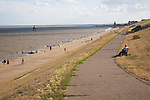 People on the seafront promenade at Dovercourt, Harwich, Essex, England