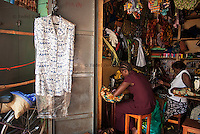 Tailors from One Mango Tree project work in their workshop in Gulu's central market, Gulu Town, Gulu District.