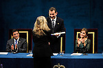 Prince Felipe of Spain gives to US photographer Annie Leibovitz the Prince of Asturias Award for Communication and Humanities during the 2013 Prince of Asturias Awards ceremony at the Campoamor Theater in Oviedo, Spain. October 25, 2013..(ALTERPHOTOS/Victor Blanco)