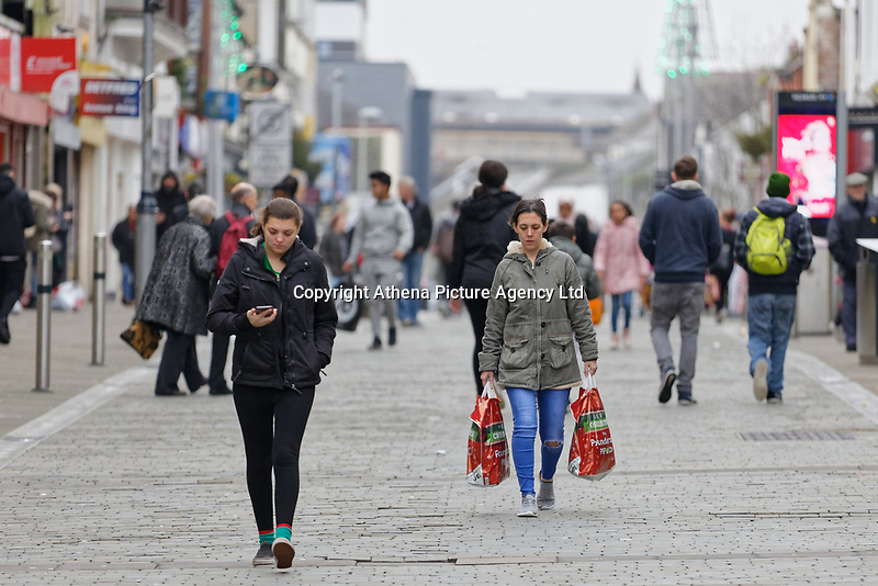 Last minute Christmas shoppers in Oxford Street, Swansea, Wales, UK. Monday 24 December 2018