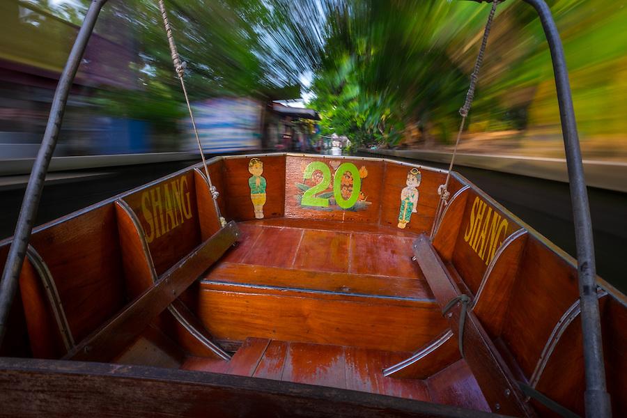 DAMNOEN SADUAK, THAILAND - CIRCA SEPTEMBER 2014: Motorboat navigating a canal close the famous floating market of Damnoen Saduak in the central region of Thailand.
