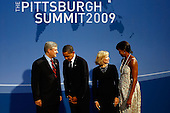 Pittsburgh, PA - September 24, 2009 -- United States President Barack Obama (2L) and U.S. first lady Michelle Obama (R) welcome Canadian Prime Minister Stephen Harper (L) and his wife Laureen Harper to the opening dinner for G-20 leaders at the Phipps Conservatory on Thursday, September 24, 2009 in Pittsburgh, Pennsylvania. Heads of state from the world's leading economic powers arrived today for the two-day G-20 summit held at the David L. Lawrence Convention Center aimed at promoting economic growth.  .Credit: Win McNamee / Pool via CNP