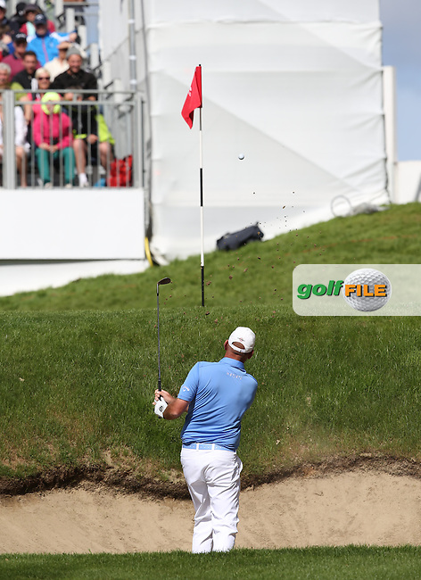 Thomas Bjorn (DEN) plays out of the bunker on the 14th and puts it close, but the par is missed during the Final Round of the BMW PGA Championship from Wentworth Golf Club, Virginia Waters, London, UK. Picture:  David Lloyd / www.golffile.ie