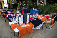 Austin, Texas - Tues., August 23, 2016 - Merchandise tables offer Trump clothing: t-shirts, hats and pins as protestors of Republican Presidential candidate Donald Trump protest across the street in downtown Austin, Texas<br />