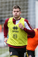 James Collins of Northampton Town warms up after being involved in the controversy at Cheltenham this week, ahead of the Sky Bet League 2 match between Stevenage and Northampton Town at the Lamex Stadium, Stevenage, England on 19 March 2016. Photo by David Horn / PRiME Media Images.