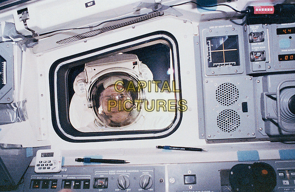 Rick Hieb peers into the flight deck.space universe galaxy gv general view spacesuit astronaut .*Editorial Use Only*.CAP/NASA/PLF.Supplied by PLF/NASA/Capital Pictures