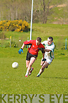 It's mine: Fossa's Fintan Coffey holds off Na Gaeil's Richard Barrett in their County League Division Four match in Fossa on Sunday.
