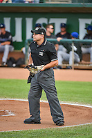 Umpire Isaias Barba handles the calls behind the plate during the Pioneer League game between the Ogden Raptors and the Missoula Osprey at Lindquist Field on July 20, 2015 in Ogden, Utah. Missoula defeated Ogden 10-6. (Stephen Smith/Four Seam Images)