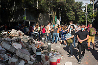 Citizens working together with the army to remove rubble and rescue trapped people. Removing rubble, recovery efforts. Amsterdam and Laredo, Condesa, Mexico City earthquake September 19 2017