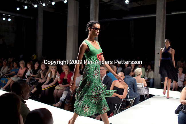 JOHANNESBURG, SOUTH AFRICA - APRIL 4:  Female models walks on the catwalk during a show at the Sanlam fashion week on April 4, 2009, Turbine Hall in central Johannesburg, South Africa. They showed Stoned Cherrie by Nkhensani, one of South Africa?s most successful designers. Buyers and celebrities watched as the best of South African fashion was shown. (Photo by: Per-Anders Pettersson/Getty Images)...