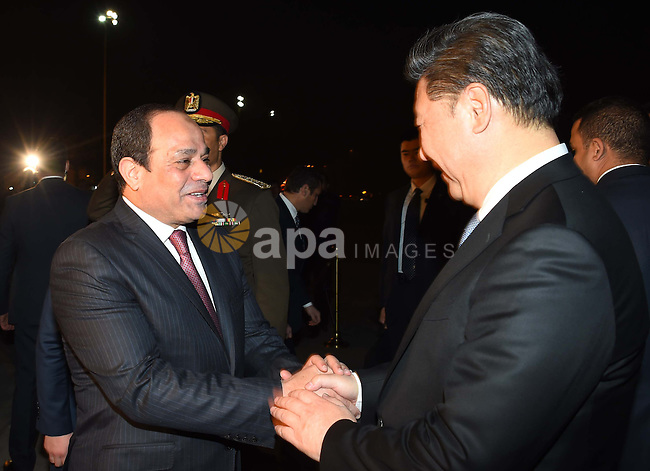 Egyptian President Abdel Fattah al-Sisi greets Chinese President Xi Jinping upon his arrival in Cairo, Egypt, January 20, 2016. Xi Jinping arrived in Cairo Wednesday for a state visit to Egypt, the second leg of his three-nation Middle East tour. Photo by Egyptian President Office