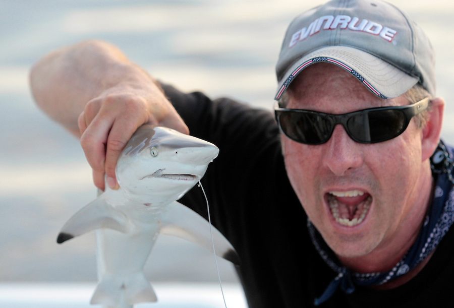 Capt. Tom Shurtleff shows off his teeth with a friendly black tip shark in Florida's Everglades National Park out of Chokoloskee Island and the 10,000 Islands National Wildlife Refuge. Photo/Andrew Shurtleff