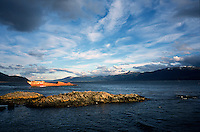 """The wreck of the Monte Sarmiento, a steam clipper that hit rocks and foundered in the Beagel Channel on April 2, 1912, sits near the former Estancia Remolino in Argentine Tierra del Fuego. At rear the """"Dog's Jaw"""" mountains rise on Chile's Navarino island."""