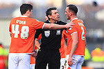 Referee Lee Probert orders Blackpool's Tom Aldred to the sideline for treatment following a cut to his face - Blackpool vs. Nottingham Forest - Skybet Championship - Bloomfield Road - Blackpool - 14/02/2015 Pic Philip Oldham/Sportimage