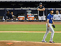 Hiroki Kuroda (Yankees), Yu Darvish (Rangers),<br /> JUNE 25, 2013 - MLB :<br /> Hiroki Kuroda of the New York Yankees watches from the dugout as Yu Darvish of the Texas Rangers is seen on the mound during the Major League Baseball game at Yankee Stadium in The Bronx, New York, United States. (Photo by AFLO)