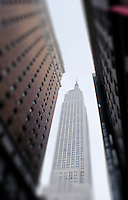 Empire State Building seen inbetween 2 other buildings.  New York 2002