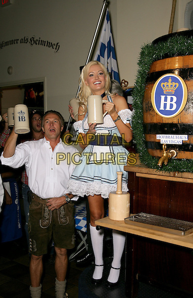 HOLLY MADISON.Peepshow co-star Holly Madison serves as the official  keg tapper at the Hofbrauhaus Las Vegas, Las Vegas, Nevada, USA,.9th October 2009..full length German costume outfit blue white frilly halterneck milk maid dress knee high socks black mary jane shoes beer barrel keg mug holding raised up arm .CAP/ADM/MJT.©MJT/Admedia/Capital Pictures