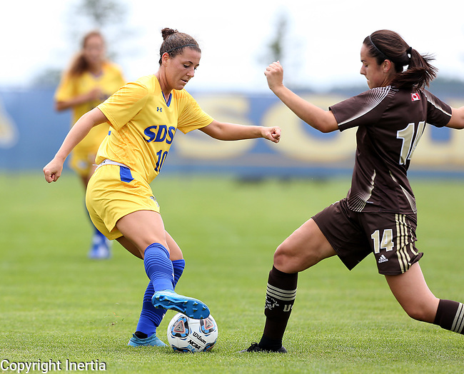 BROOKINGS, SD - AUGUST 13: Nicole Hatcher #10 from South Dakota State controls the ball in front of Haydn Christensen Burdeny #14 from Manitoba during the first half of their exhibition match Sunday afternoon at Fishback Soccer Park in Brookings. (Photo by Dave Eggen/Inertia)
