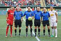 Portland, Oregon - Sunday September 11, 2016: Portland Thorns FC forward Christine Sinclair (12) and Western New York Flash midfielder Abby Erceg (6) during a regular season National Women's Soccer League (NWSL) match at Providence Park.