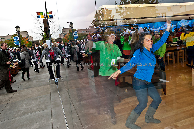 10/20/2011--Seattle, WA, USA..Microsoft store employees play on X-Box Kinnect...Microsoft (MSFT) opened their 12th retail store in Seattle's U-Village shopping center today. Nearly 1000 people waited in line for the opening of the company's first store in Seattle. The store opened up directly across from an Apple store. Nationwide, Microsoft will open two more this fall, in California and Virginia. ..©2011 Stuart Isett. All rights reserved.
