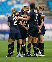 USWNT midfielder (16) is surrounded by teammates after scoring during the finals of the Peace Queen Cup.  The USWNT defeated Canada, 1-0, at Suwon World Cup Stadium in Suwon, South Korea.
