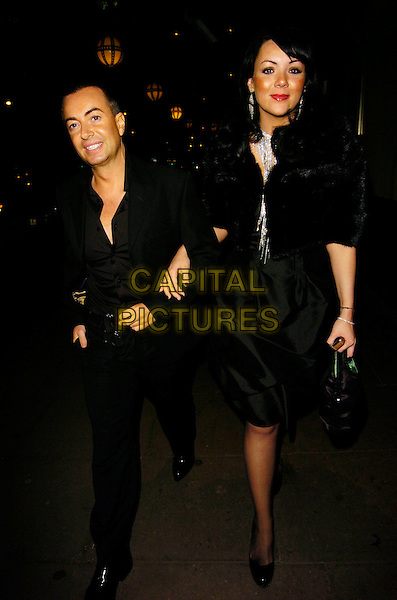 JULIEN MACDONALD & MARTINE McCUTCHEON.At Andy & Patti Wong's Chinese New Year Party,.Madame Tussards,London, England, January 27th 2007..full length black shirt dress tanned bronzer red lipstick.CAP/CAN.©Can Nguyen/Capital Pictures