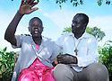 UGANDA BRAILLE BIBLE CASE STUDIES. BISANTINA ACHOLA, 56, WITH REV RICHARD OPIO, 45, IN DOKOLO,  UGANDA. PHOTO BY CLARE KENDALL. 25/9/13
