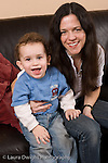 2 year old toddler boy at home with mother portrait happy vertical