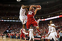 March 9, 2014: Benny Parker (3) of the Nebraska Cornhuskers fouls Josh Gasser (21) of the Wisconsin Badgers during the first half at the Pinnacle Bank Arena, Lincoln, NE. Nebraska 77 Wisconsin 68.