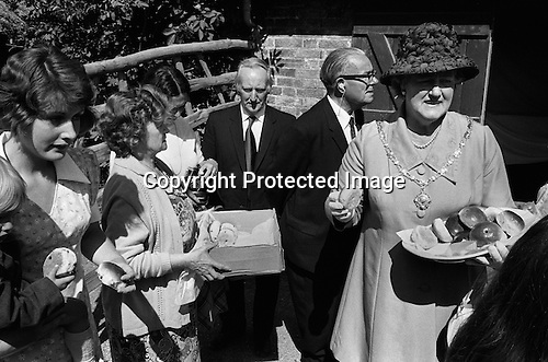 Sandwich Kent England 1975. August 24th St Bartholomew's Bun Race. The Bartlemas Bun Race. Lady Mayoress hands out buns at end of race...