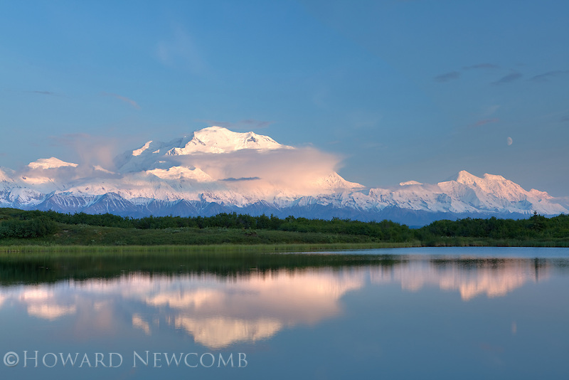 During the first week of summer in Denali National Park, Alaska the setting sun casts a soft light on Mt. McKinley at midnight.